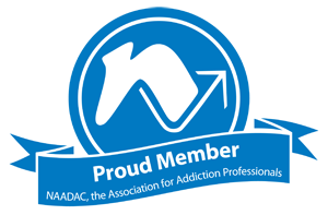 Badge: Proud Member NAADAC, the association for addiction professionals | Kelly Benjamin | Therapy for Mood Disorders & Addiction Counseling | Columbia, SC 29201